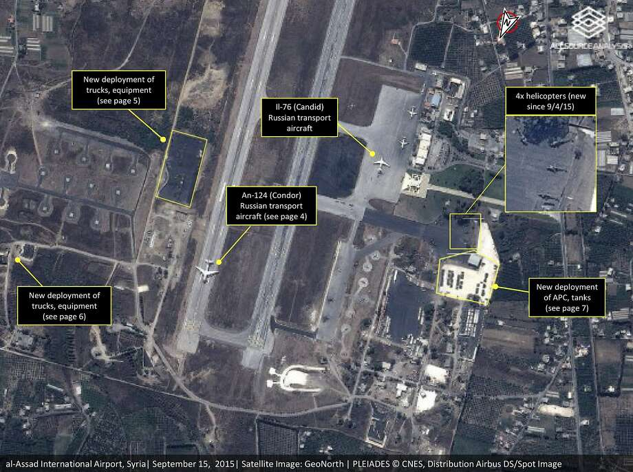 This satellite image shows Russian transport aircraft, helicopters, tanks, trucks and armed personnel carriers at an air base in Latakia province, Syria. Photo: Associated Press