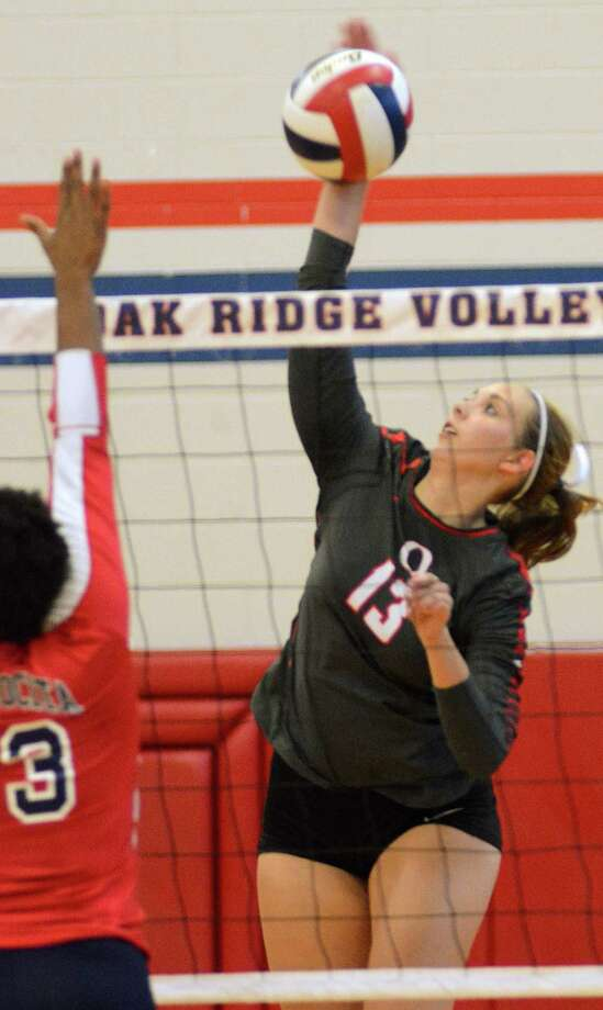 Oak Ridge's Brooke Clark spikes the ball during the Atascocita at Oak Ridge volleyball game.Photograph by David Hopper. Photo: David Hopper, Freelance / freelance
