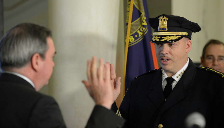 New Schenectady Police Chief Brian Kilcullen takes the oath of office from Mayor Gary McCarthy during a ceremony at City Hall, Monday, Jan. 7, 2013, in Schenectady, N.Y. (Skip Dickstein/Times Union) Photo: SKIP DICKSTEIN / 00020667A