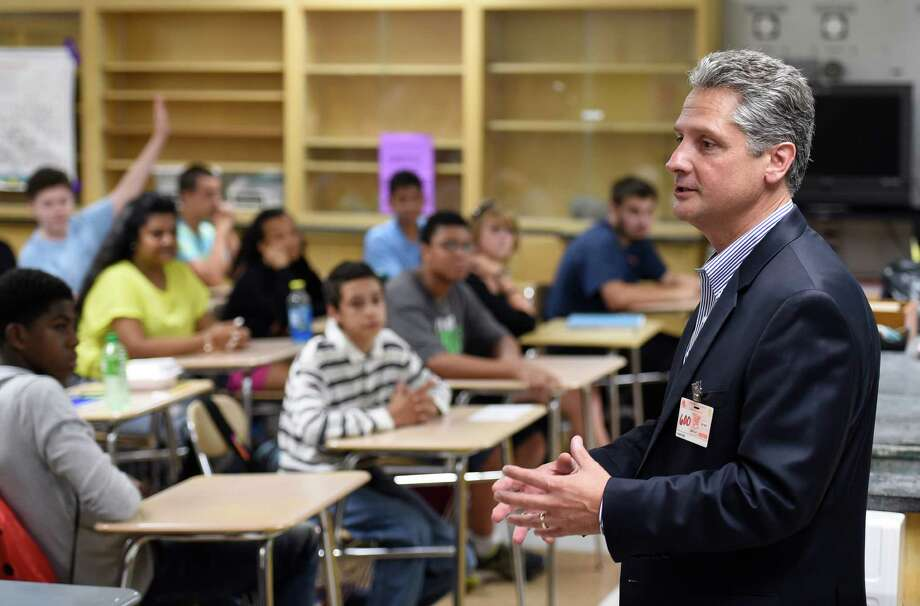 Vic Abate, president and CEO of Power Generation for GE Power and Water division addresses a chemistry class at the Schenectady High School Friday morning Sept. 18, 2015 in Schenectady, N.Y.   Abate gave a check for $25,000 to the Schenectady City School District before entering the classroom.   (Skip Dickstein/Times Union) Photo: SKIP DICKSTEIN / 00033430A
