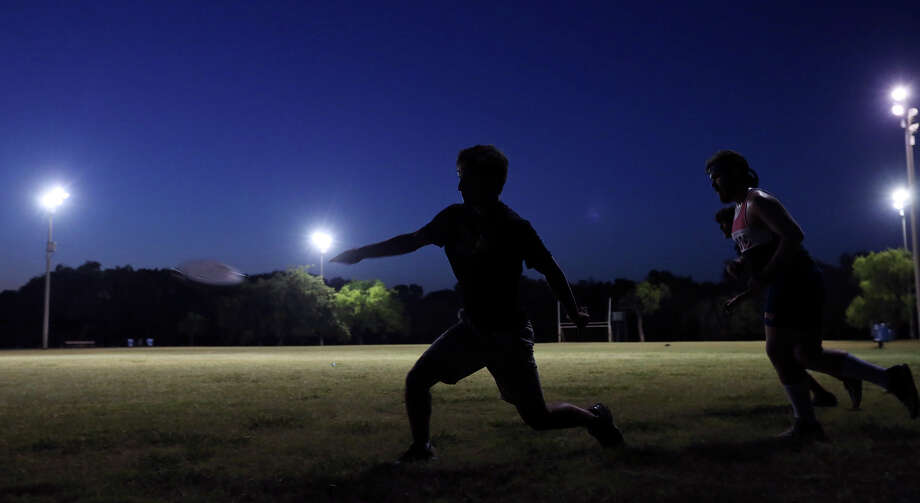 Trying to beat the heat local students play ultimate frisbee at Olmos Basin Park Saturday evening Aug 1, 2015. Photo: Edward A. Ornelas, Staff / San Antonio Express-News / © 2015 San Antonio Express-News
