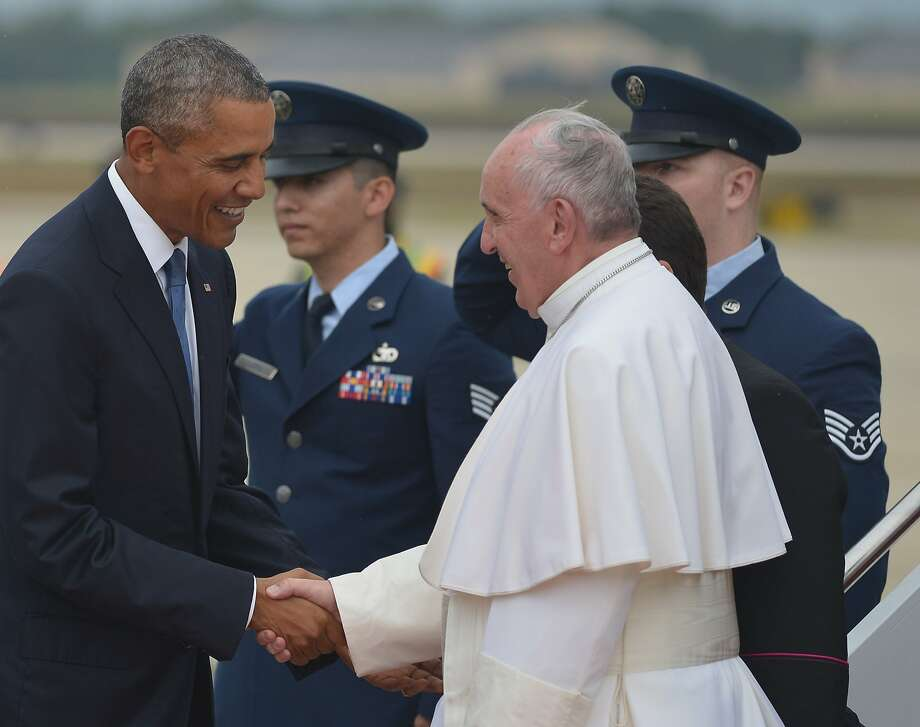 President Obama greets Pope Francis upon his arrival at Andrews Air Force Base in Maryland. Photo: Mandel Ngan, AFP / Getty Images