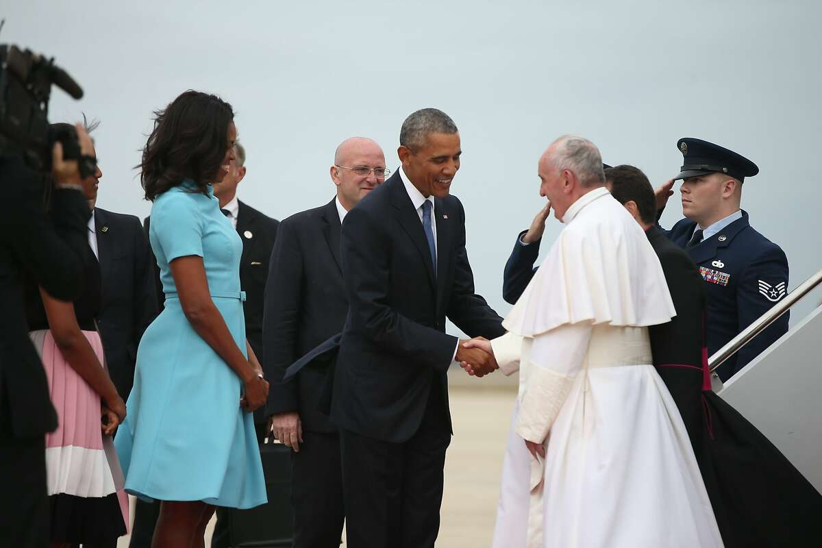 TAKE A BUS Tyler Lomnitzer of Trumbull and David Janny, who both attend St. Catherine of Siena church, have arranged buses for members of the Bridgeport Diocese who plan to attend the Sept. 27 Papal Mass in Philadelphia.Pictured: President Barack Obama and first lady Michelle Obama greet Pope Francis upon his arrival at Andrews Air Force Base, Md., Tuesday, Sept. 22, 2015. (AP Photo/Andrew Harnik)