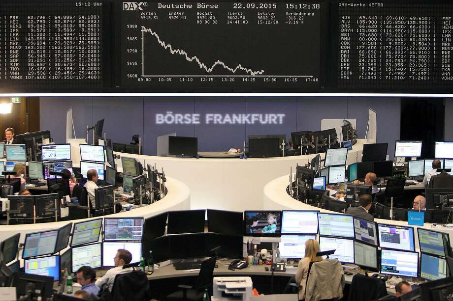 A board displays the chart of Germany's DAX index at the stock exchange in Frankfurt. It was pushed down by plummeting shares of Volkswagen. Photo: Daniel Roland, AFP / Getty Images