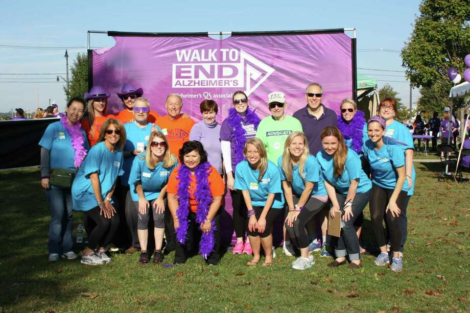 The Fairfield County Walk To End Alzheimer's Event Committee 2015 includes: Back Row: Sue Martins, Jojo Frey, Max Snyder, Mike Davis, Christy Perone, Claire Rowella, Dick Fisher, Len Schwartz, Heidi Lohrfink, Kelley Green; Front Row: Diane Mastrone, Howard Bloom, Bonnie Leavy-Mello, Giovanna LoSardo, Lorin Richardson, Lindsay Johnson, Tania Paparazzo, Lexi Kennedy; Photo: Contributed Photo / Connecticut Post / Connecticut Post
