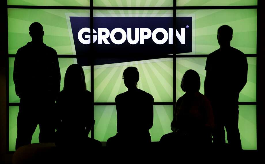 Groupon, which offers online coupons, is cutting back many of its foreign operations. Photo: Charles Rex Arbogast, Associated Press