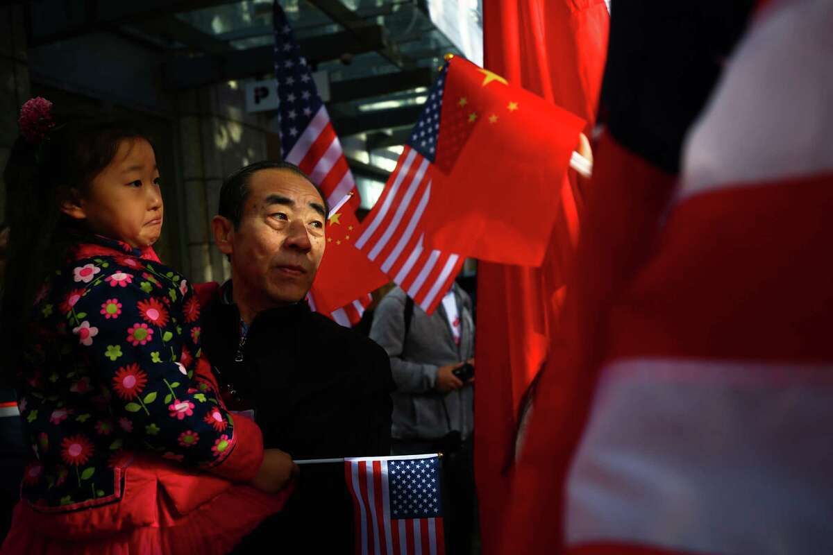 Hundreds gathered near the Westin Hotel in downtown Seattle Tuesday morning to greet Chinese President Xi Jinping after his arrival in Everett, September 22, 2015.
