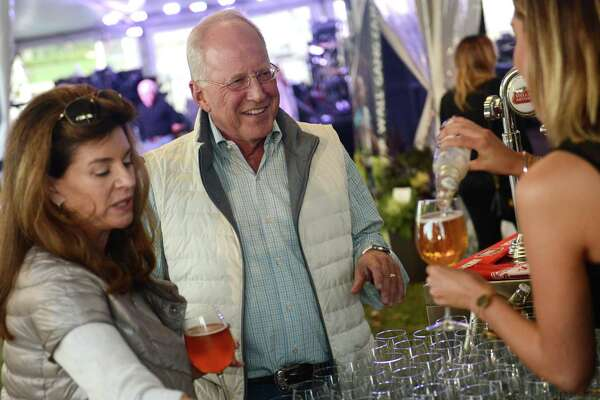 Schuiler and Charlie Hinnant, of Rowayton, try a glass of Stella Artois during day two of the Greenwich Wine + Food Festival at Roger Sherman Baldwin Park in Greenwich, Conn. Friday, Sept. 26, 2014. The 2015 festival begins Wednesday and continues through the weekend.