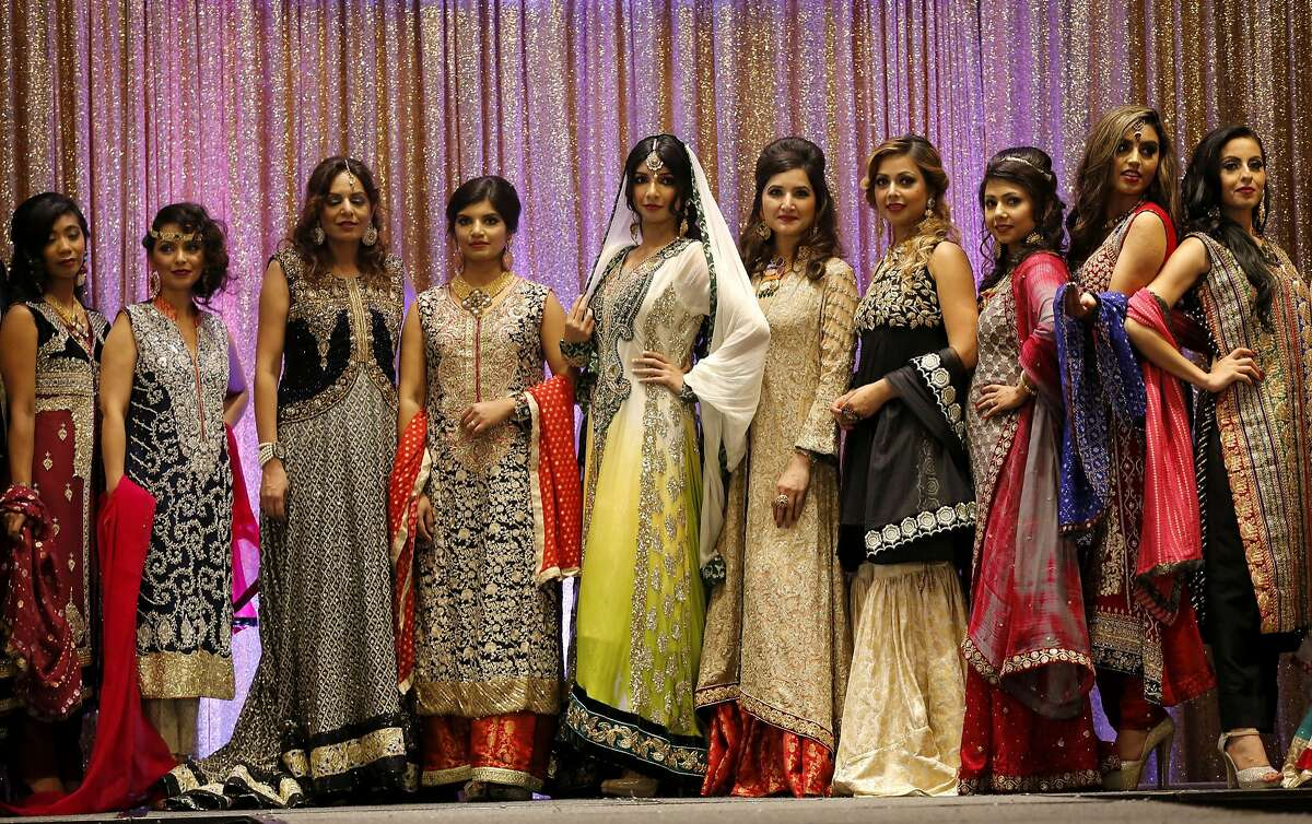 Models show off different styles of wedding dresses at the Perfect Muslim Wedding Expo in Newark, California, on Sunday, Sept. 20, 2015.