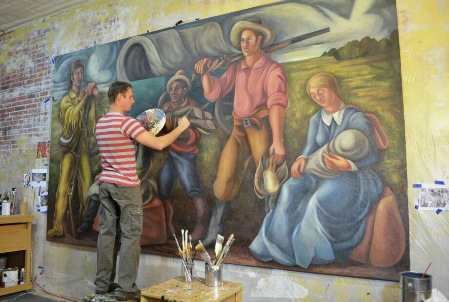 Lee Casbeer restores éEmigrants at Nightfallé by Loren Mozley, a mural was displayed for 24 years in the former Alvin Post Office. The mural, commissioned as part of the President Franklin D. Rooseveltés New Deal, was folded and stored in the basement until a restoration effort. It will be displayed in the same building, which now is the  Alvin Historical Museum. Photo: Courtesy