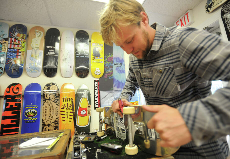 Kerry McCullough, of Bridgeport, new owner of Day One skate shop. works on a skateboard at the store's new location at 25 South Benson Road in Fairfield, Conn. on Tuesday, September 22, 2015. Photo: Brian A. Pounds / Hearst Connecticut Media / Connecticut Post