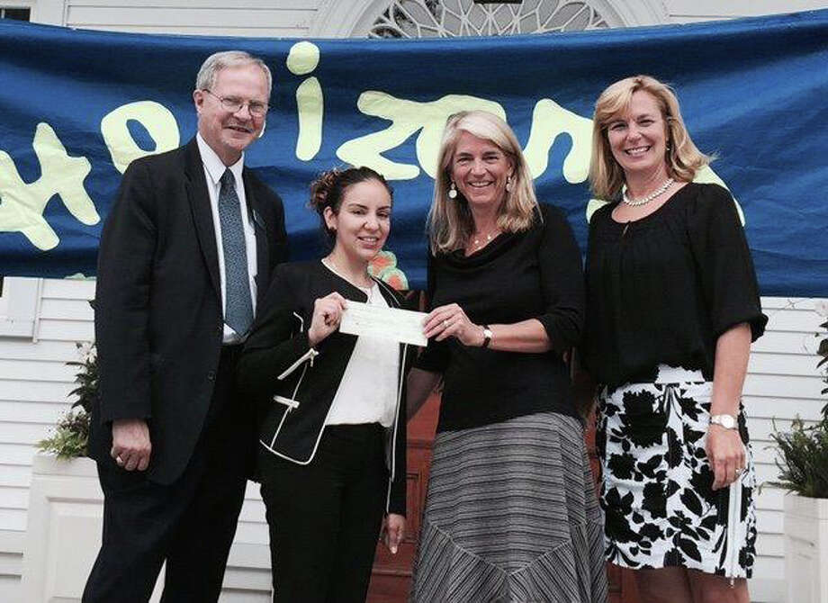 David Van Buskirk, AVP business development officer, and Aitza Cabrera, AVP branch manager, both of First County Bank, present Kerry Y. Stevens, executive director, and Amy M. Stevens, interim director of development, both of Horizons Student Enrichment Program at New Canaan Country School, with a $5,000 First County Bank Foundation grant for its six-week summer program for children in kindergarten through eighth grade. Photo: Contributed / Contributed Photo / New Canaan News