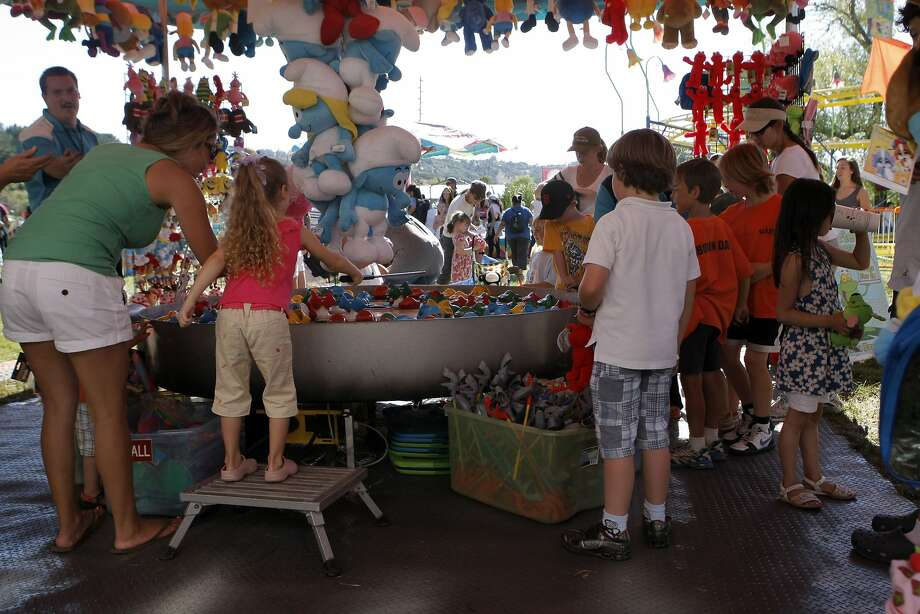 Kids crowded around a fishing game in the hopes of winning a prize at the Marin County Fair in San Rafael in 2011. Photo: Audrey Whitmeyer-Weathers, The Chronicle