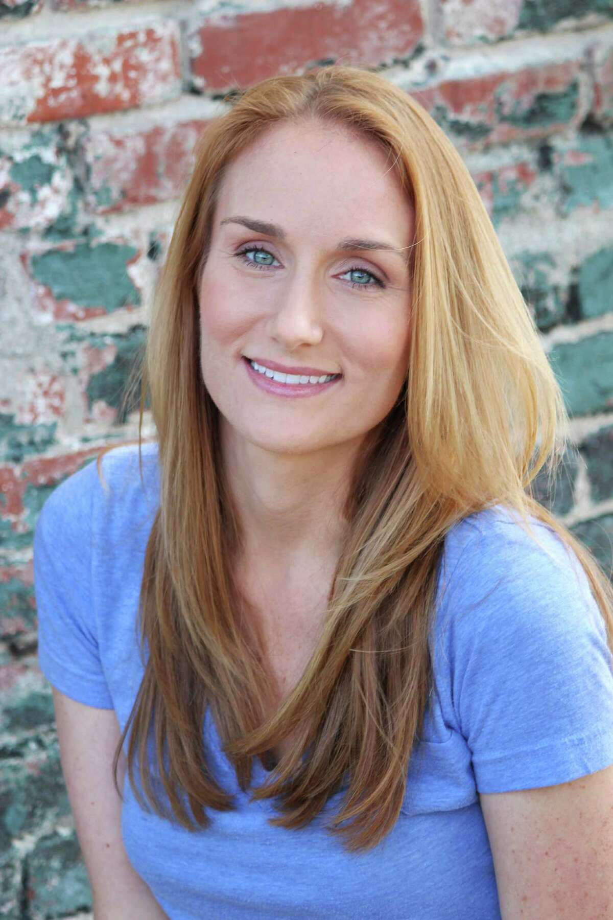 """Houston native Elizabeth Collins brings her solo show """"Raised by Gays and Turned Out OK!"""" home to the Houston Fringe Festival."""