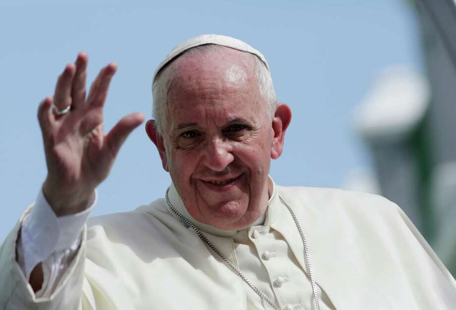 """Pope Francis waves from his popemobile in Santiago de Cuba, Cuba, Tuesday, Sept. 22, 2015. Pope Francis left Cuba on Tuesday for his first trip to the U.S., wrapping up a four-day visit to the island with an appeal to the people to rediscover their Catholic heritage and live a """"revolution of tenderness."""" (Enrique De La Osa/Pool via AP) Photo: Enrique De La Osa / Associated Press / Reuters Pool"""