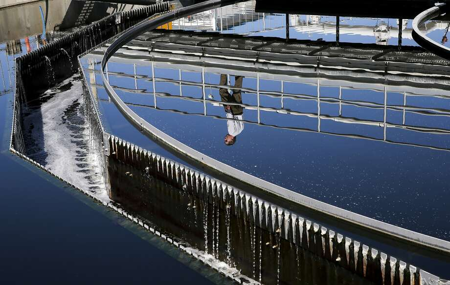 Plant operations manager Dan Gallagher is seen reflected in a secondary clarifier as recycled water travels through the cleaning process, during a tour of the Dublin San Ramon Regional Wastewater Treatment Facility in Pleasanton, Calif. on Tues. September 22, 2015. Photo: Michael Macor, The Chronicle