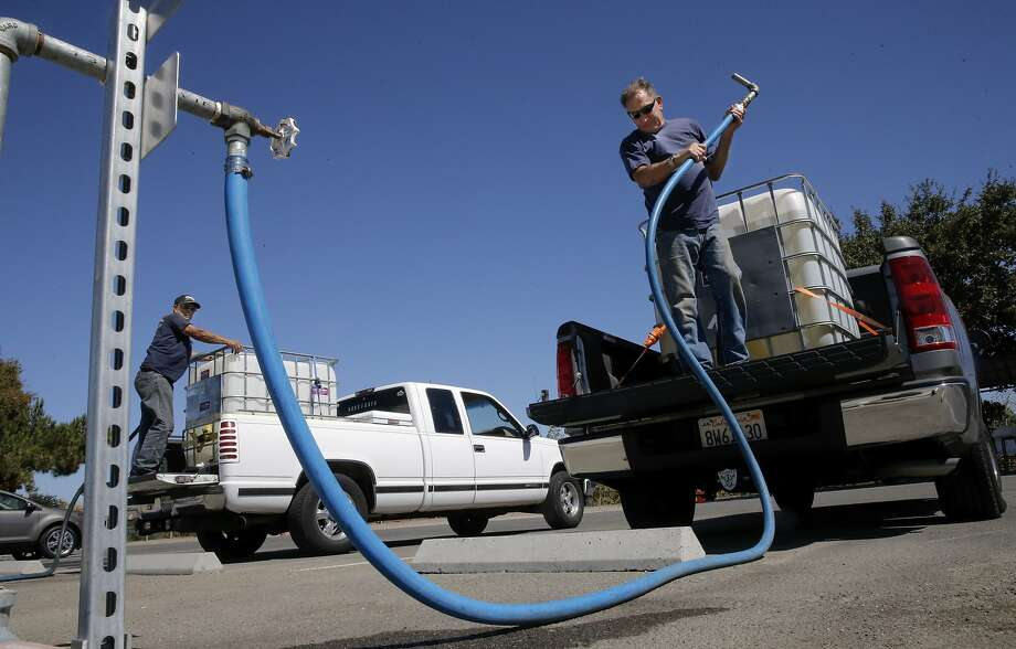 Randy Laird of Dublin finishes filling his tank with recycled water at the Dublin San Ramon Regional Wastewater Treatment Facility. Photo: Michael Macor, The Chronicle