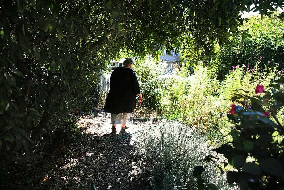 Writer Dana Velden in her Oakland garden. Photo: Liz Hafalia, The Chronicle