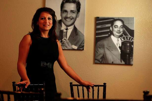 Christina Morales-Berger owner of the newly-opened Morales Radio Hall, which was once the headquarters for KLVL Radio Station, which stood for La Voz Latina, a historic Spanish language radio station, photographed with photos of her father, Joe Morales, and grandfather Felix Morales on Wednesday, Sept. 16, 2015. ( Karen Warren / Houston Chronicle )