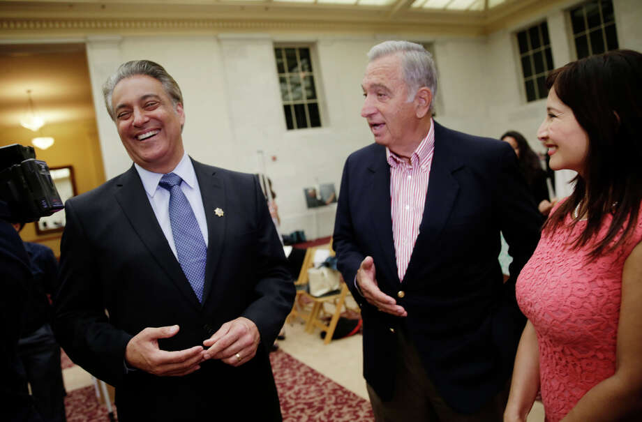 After accepting an award from Harvard, S.F. Sheriff Ross Mirkarimi (left) and his wife, Eliana Lopez, enjoy a moment with former Mayor Art Agnos. Photo: Lea Suzuki / Lea Suzuki / The Chronicle / ONLINE_YES