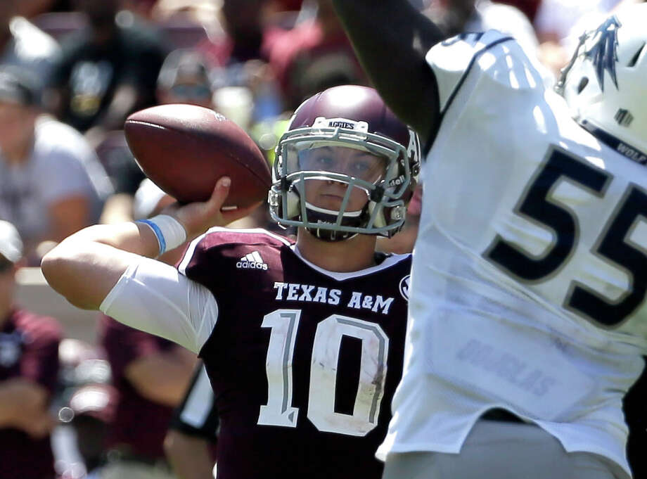 Texas A&M quarterback Kyle Allen (10) throws a pass as Nevada defensive lineman Rykeem Yates (55) defends during the second half of an NCAA college football game Saturday, Sept. 19, 2015, in College Station, Texas. Photo: David J. Phillip /Associated Press / AP