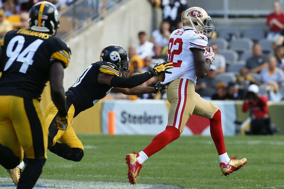 The 49ers' Torrey Smith heads for the end zone on a 75-yard touchdown reception in the fourth quarter at Pittsburgh. Photo: Gene J. Puskar, Associated Press