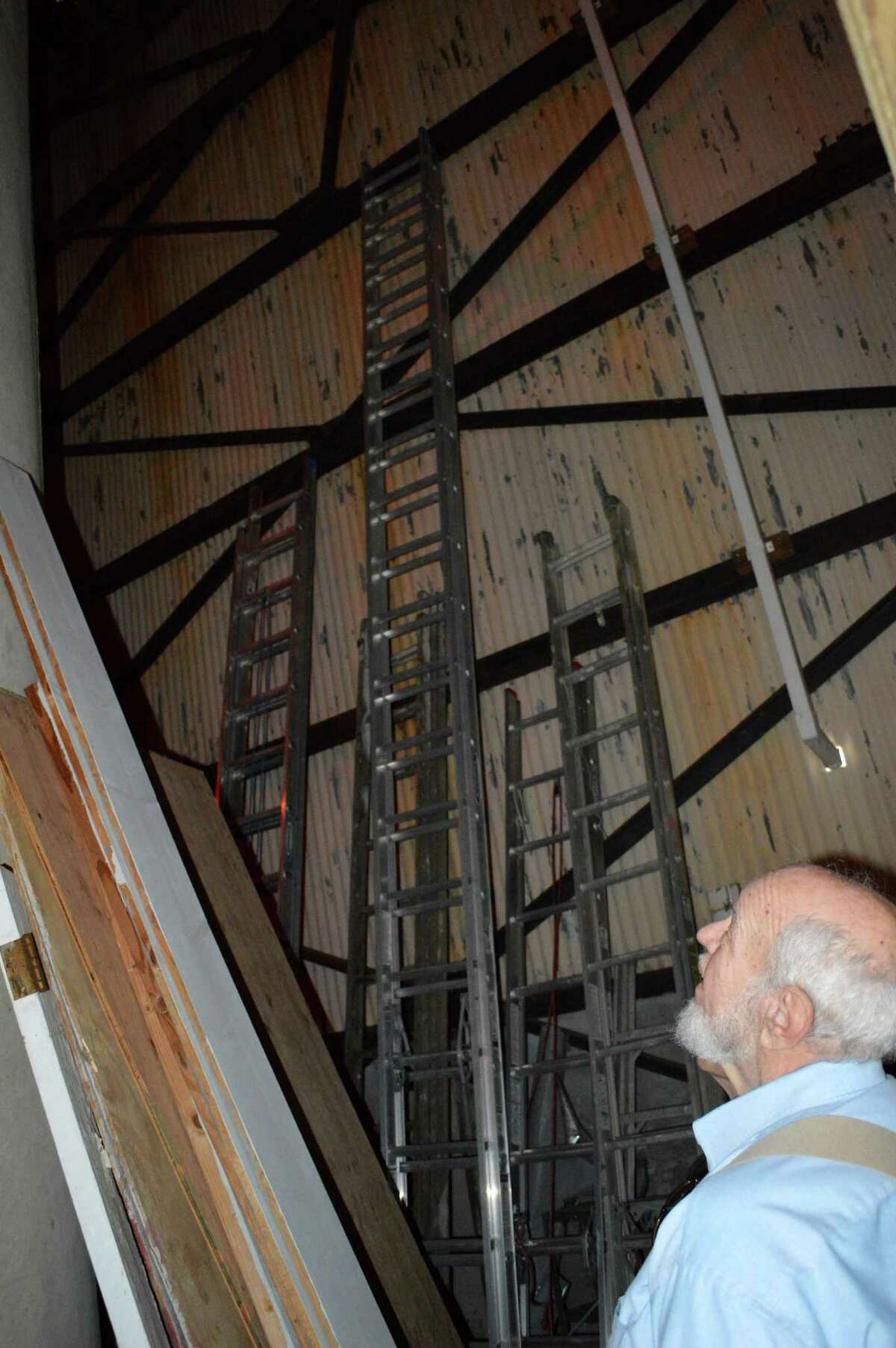 Industrial archaeologist Bob Stewart examines the inside of the former Nike radar installation's south tower, where the Rolnick Observatory is now housed.