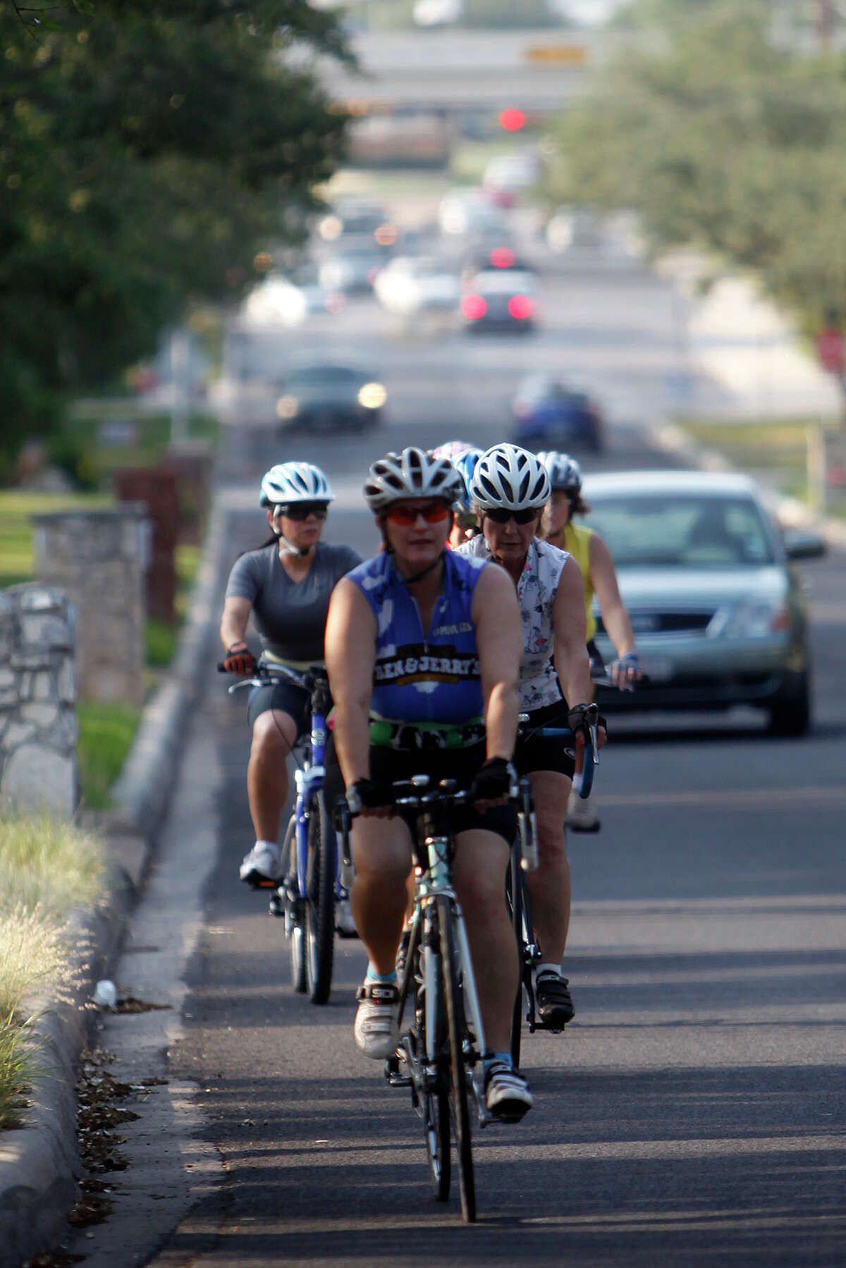 Cars have to give bicyclists three feet of space when passing; larger trucks have to allow six feet.