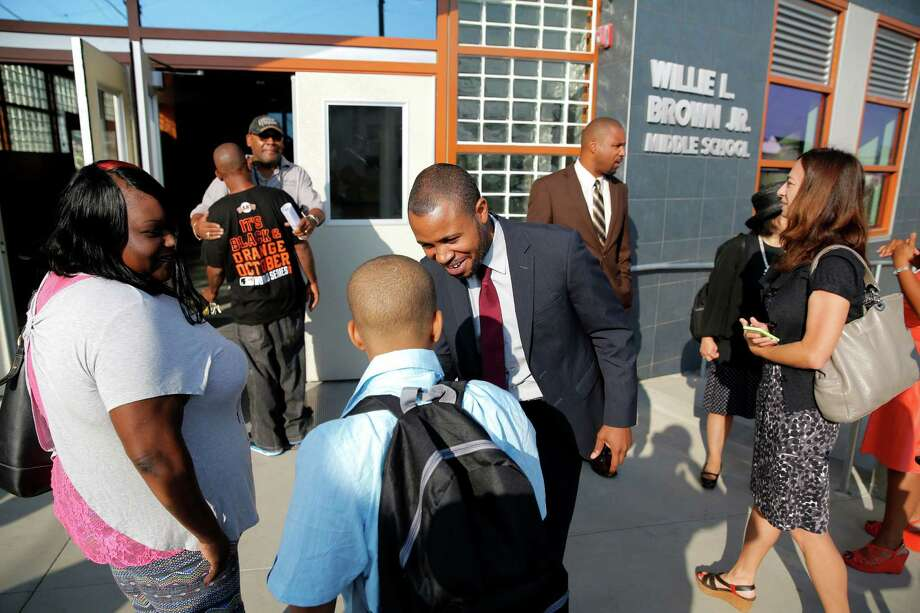 Principal Demetrius Hobson (center) greets students and parents at Willie L. Brown Jr. Middle School on Aug. 17. Barely a month later, Hobson resigned. Photo: Connor Radnovich / Connor Radnovich / The Chronicle / ONLINE_YES