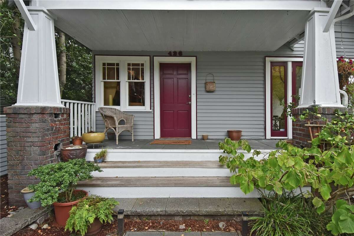 Front porch and entrance at 426 N. 62nd St. in Phinney Ridge. The four-bedroom, 2.75-bathroom home is listed at $875,000.