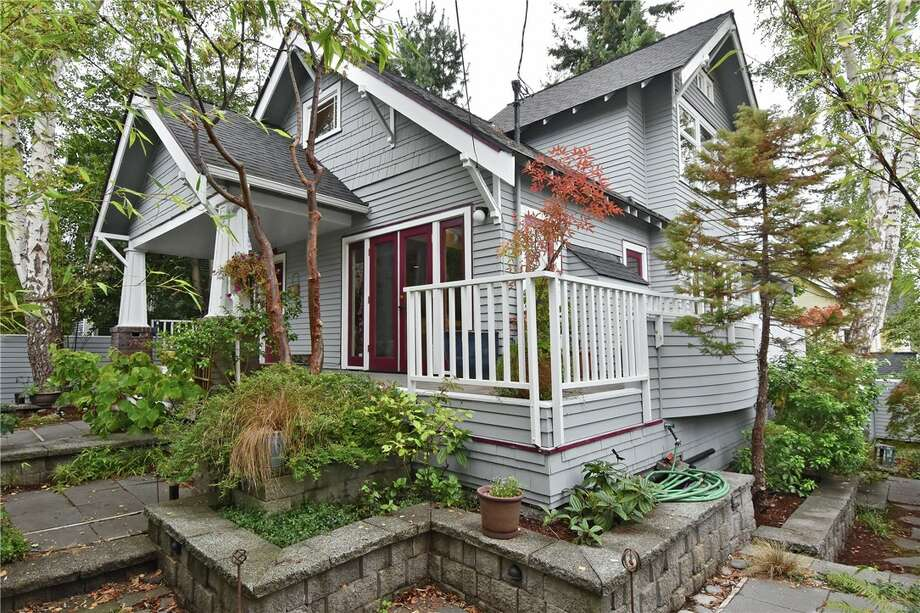 Exterior of 426 N. 62nd St. in Phinney Ridge. The four-bedroom, 2.75-bathroom home is listed at $875,000.The upper-level master bedroom has views of Green Lake and sunrises. Built in 1923, it includes a daylight basement and is situated on a corner lot. An open house is set to take place from 11:30 a.m. to 1:30 p.m. Wednesday. Photo: David Rush/Windermere Real Estate Co.