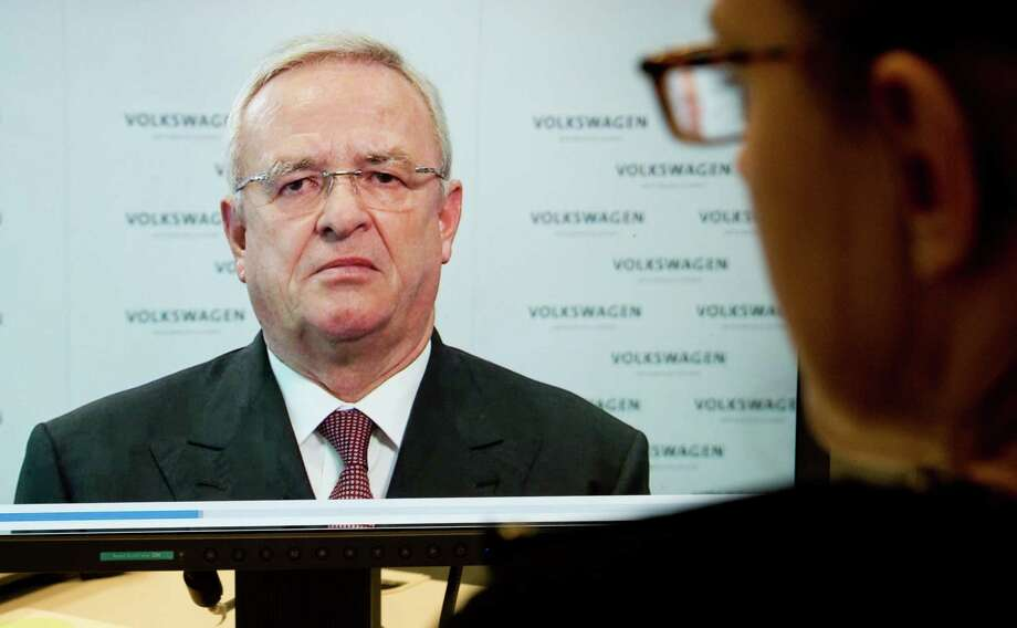 A woman watches a video statement by Volkswagen AG  CEO Martin Winterkorn, on the company's website, in Hanover, Germany,  Tuesday Sept. 22, 2015. Winterkorn  apologized   for the manipulations  of  VW  diesel cars  in the U.S. to defeat  emission tests , and promised    a fast and thorough investigation. (Julian Sratenschulte/dpa via AP) ORG XMIT: MVW101 Photo: Julian Stratenschulte / dpa