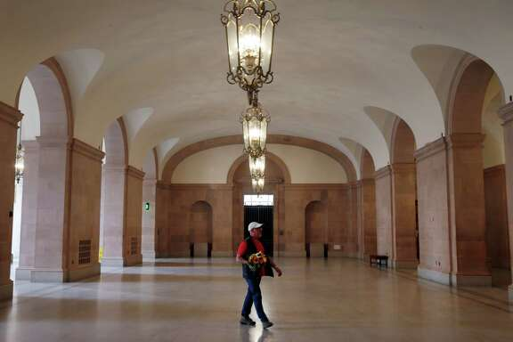 A visitor walks through the lobby of the newly renovated War Memorial Veterans Building in San Francisco, Calif. on Tuesday, Sept. 22, 2015.