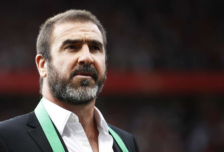 FILE - This is a Friday Aug. 5, 2011 file photo of former Manchester United soccer player Eric Cantona as he stands on the pitch before a testimonial soccer match for former Manchester United player Paul Scholes at Old Trafford Stadium, Manchester, England.   Cantona told France Inter radio Tuesday Sept. 22, 2015, that he is setting up a scheme with authorities in Marseille to lend a 50 square meter house, along with a large garden, to people fleeing war and poverty in the Middle East and Africa. (AP Photo/Jon Super, File) Photo: Jon Super, Associated Press