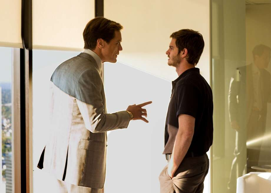 """Michael Shannon (left) and Andrew Garfield in """"99 Homes."""" Photo: Broad Green Pictures"""