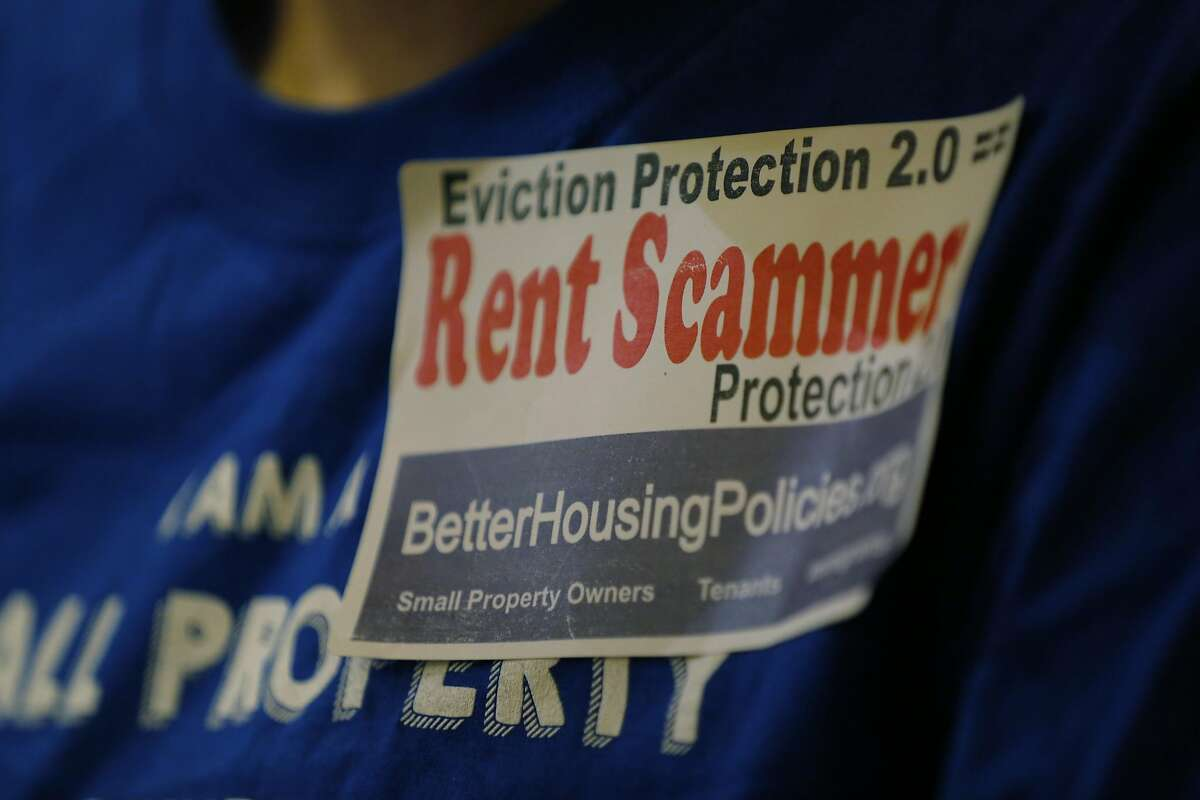 A sticker on the shirt of an opponent of new eviction protection legislation at a San Francisco Board of Supervisors meeting at City Hall in San Francisco, California, on Tuesday, Sept. 22, 2015.