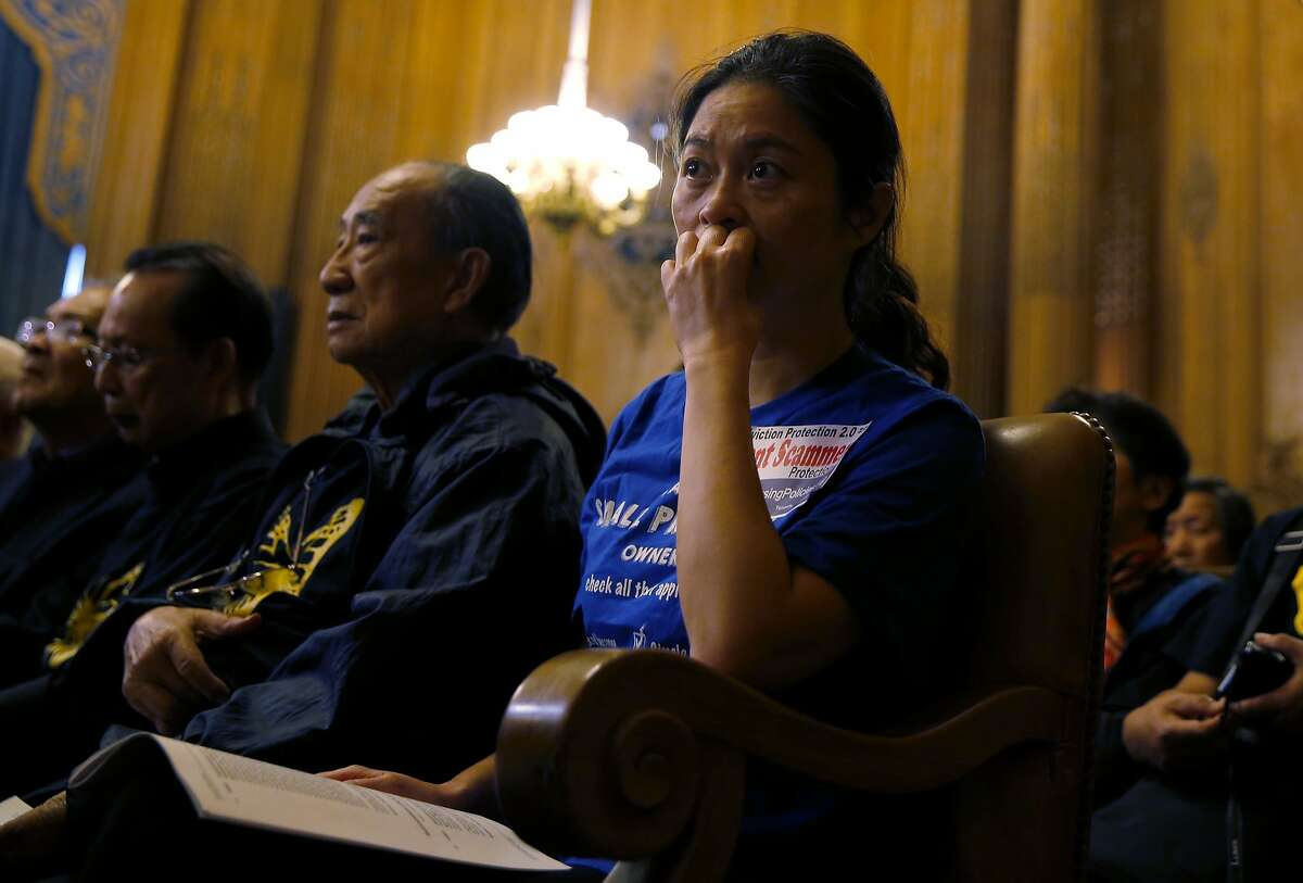 Josephine Zhao listens to supervisors discuss eviction protection legislation at a San Francisco Board of Supervisors meeting at City Hall in San Francisco, California, on Tuesday, Sept. 22, 2015.