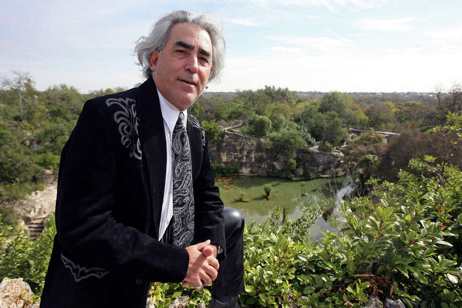 John Philip Santos stands stands on the ground above Sunken Gardens in Brackenridge Park, one of his favorite spots for inspiration. Photo: Tom Reel / San Antonio Express-News / treel@express-news.net