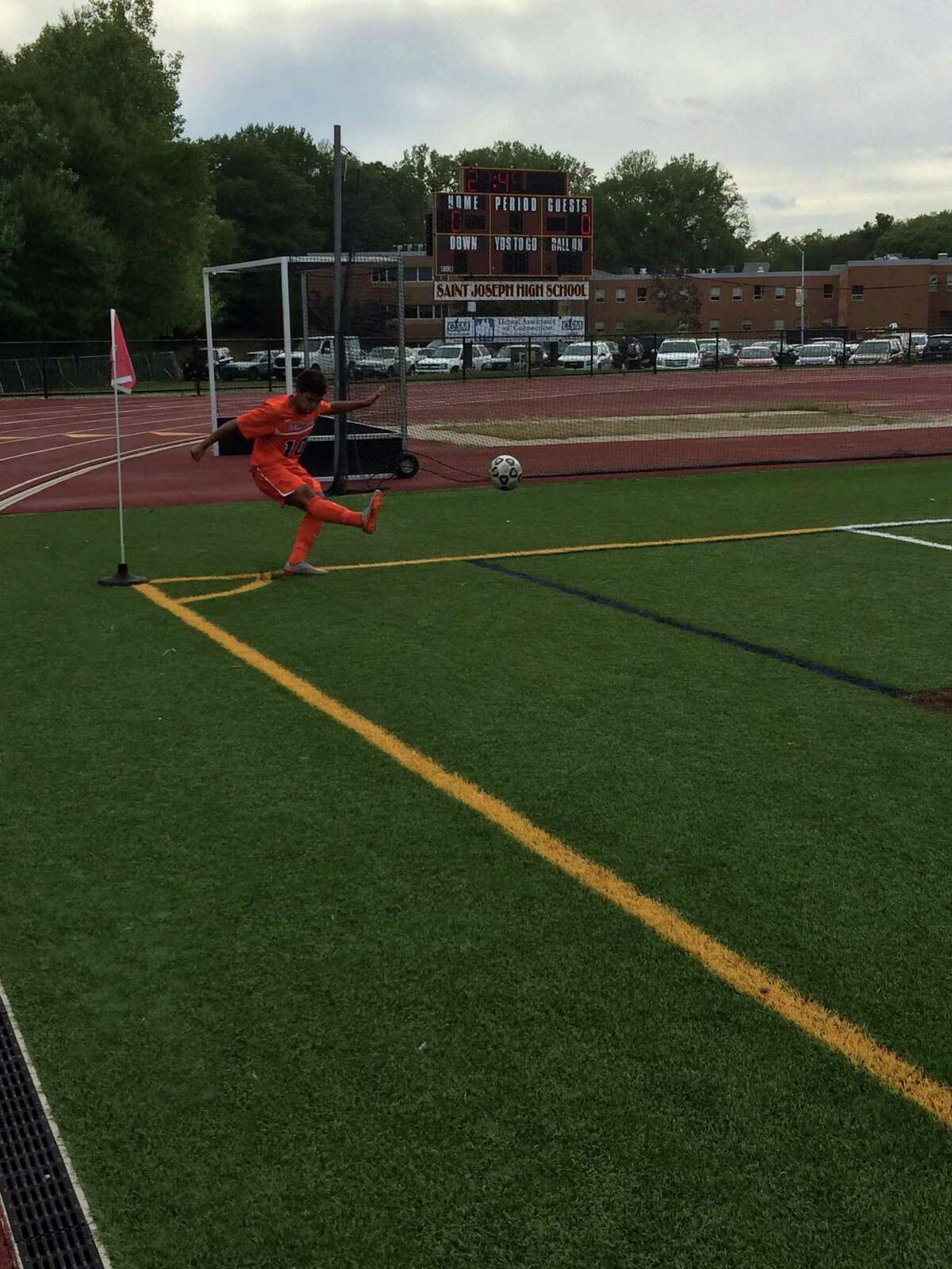 Danbury forward Edwin Rosano attempts a corner kick against St. Joseph on Tuesday in Trumbull.