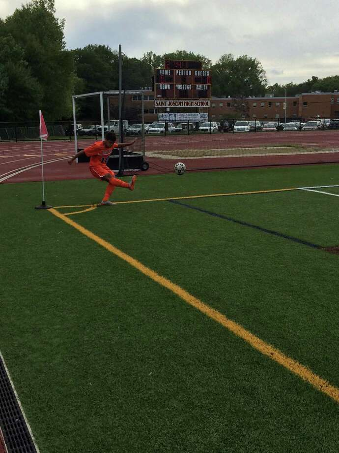 Danbury forward Edwin Rosano attempts a corner kick against St. Joseph on Tuesday in Trumbull. Photo: Doug Bonjour /Hearst Connecticut / Contributed Photo / Doug Bonjour/Hearst Connecticut Media