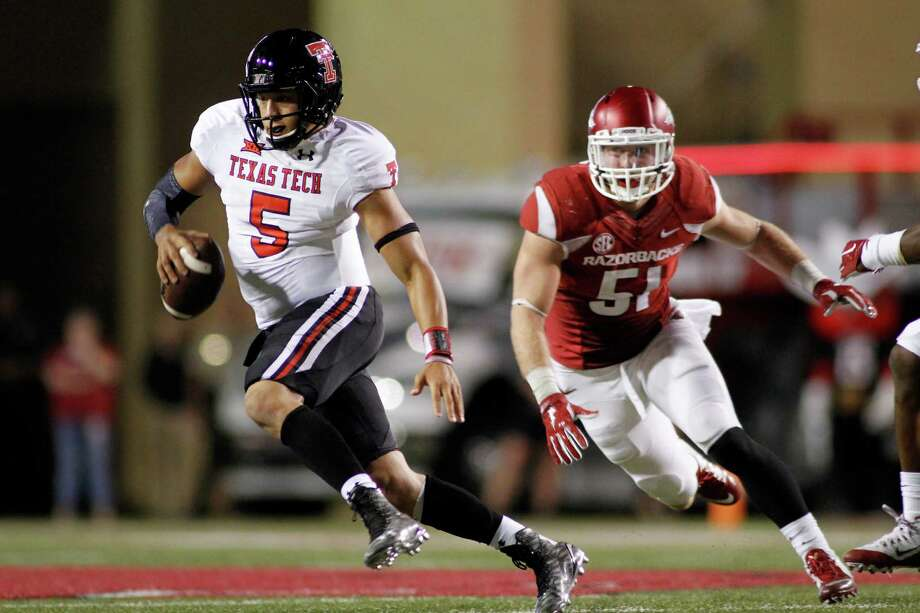 Arkansas linebacker Brooks Ellis (51) chases Texas Tech quarterback Patrick Mahomes II during the second half of an NCAA college football game, Saturday, Sept. 19, 2015, in Fayetteville, Ark. Texas Tech beat Arkansas 35-24. (AP Photo/Samantha Baker) Photo: Samantha Baker, FRE / FR171351 AP