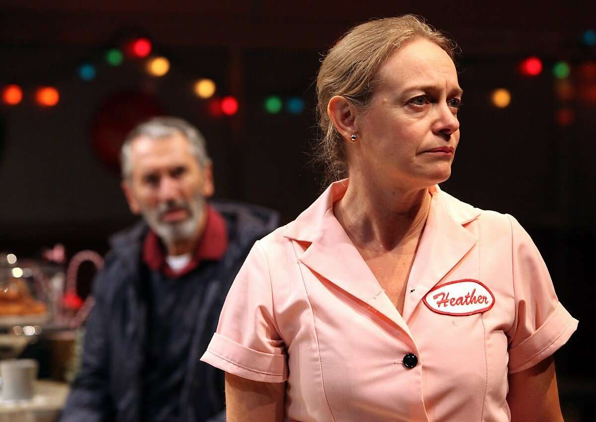 """Heather (Julia McNeal, right) listens as regular customer Sunny (Terry Lamb) recounts his drive on the motorway in """"Fred's Diner"""" at the Magic Theatre"""