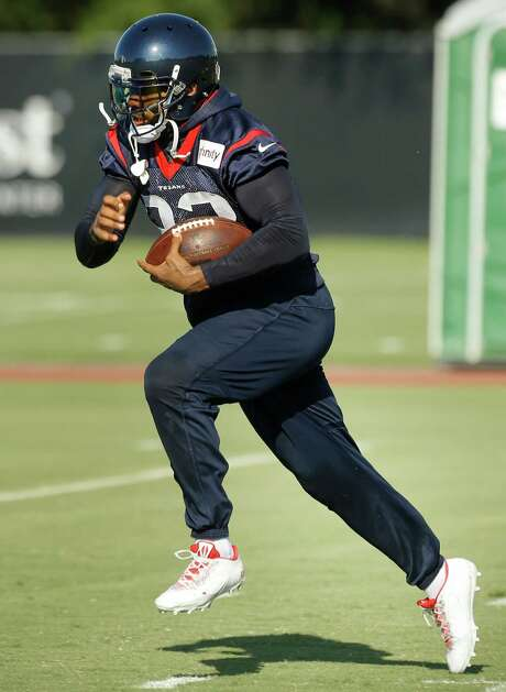 Houston Texans running back Arian Foster runs with the football during Texans training camp at the Methodist Training Center Sunday, Aug. 2, 2015, in Houston. Foster suffered a severe groin injury in Monday night's practice will require surgery, according to published reports. The Texans have declined comment on the injury. ( Brett Coomer / Houston Chronicle ) Photo: Brett Coomer, Staff / © 2015 Houston Chronicle