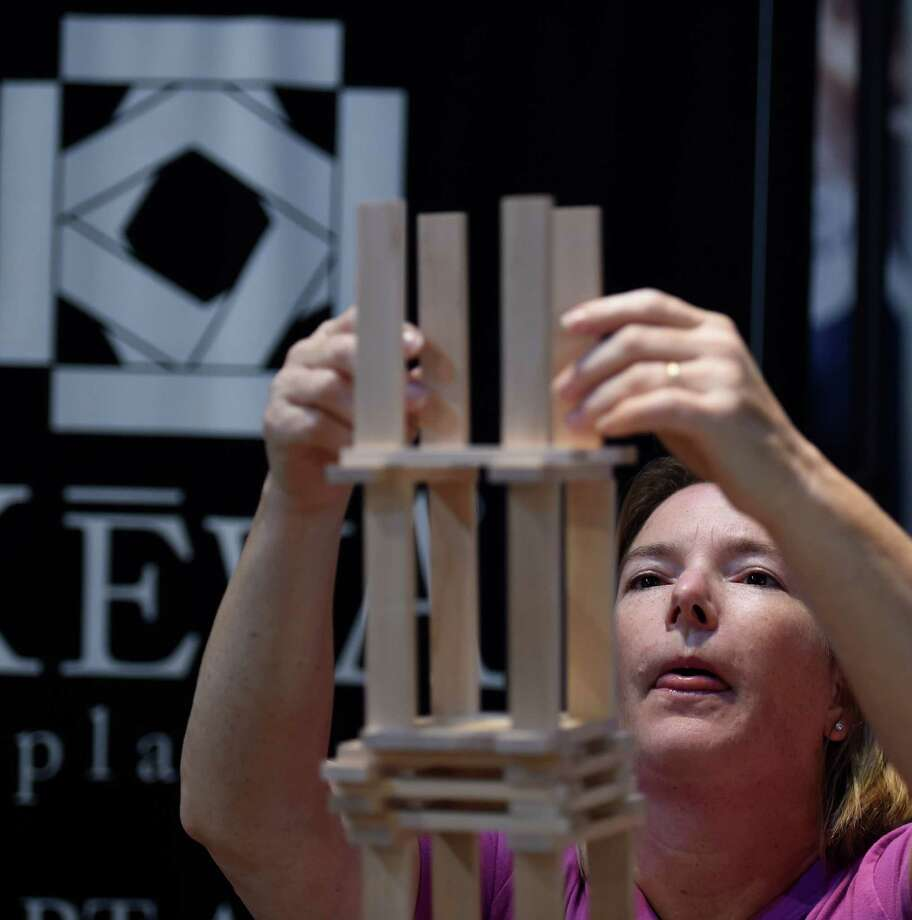 Katie Beltramo of Kids Out and About an online resource for kids and families, competes in the KEVA building challenge to promote the opening of the Design, Build, Create, KEVA! exhibit at the miSci Tuesday afternoon Sept. 22, 2015 in Schenectady, N.Y.     (Skip Dickstein/Times Union) Photo: SKIP DICKSTEIN / 00033452A