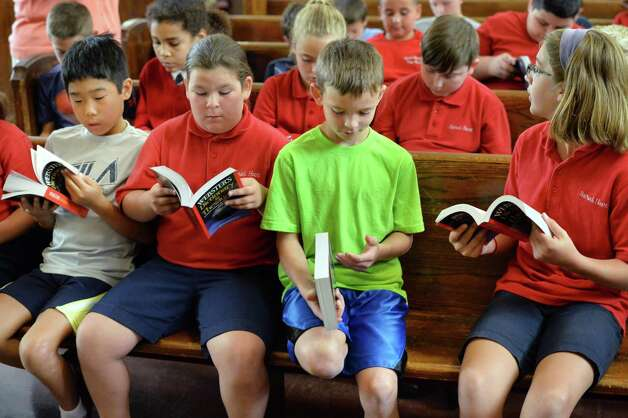 Sacred Heart School third graders check out dictionaries given them by BPO ELKS Troy Lodge #141 members at the school Tuesday Sept. 22, 2015 in Troy, NY.  (John Carl D'Annibale / Times Union Photo: John Carl D'Annibale / 00033447A