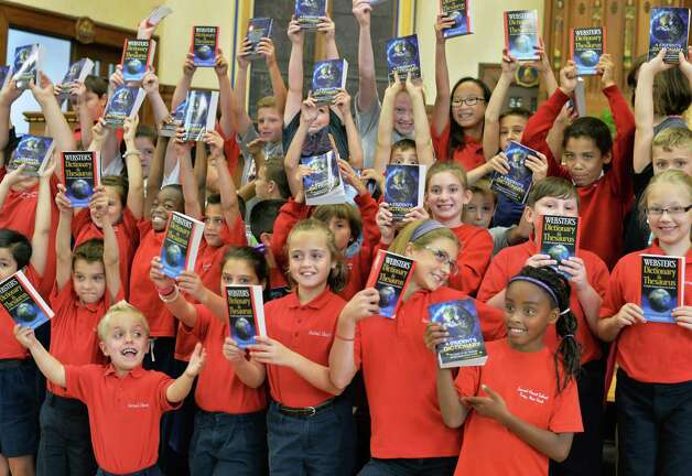 Sacred Heart School third graders with dictionaries given them by BPO ELKS Troy Lodge #141 members at the school Tuesday Sept. 22, 2015 in Troy, NY.  (John Carl D'Annibale / Times Union Photo: John Carl D'Annibale / 00033447A
