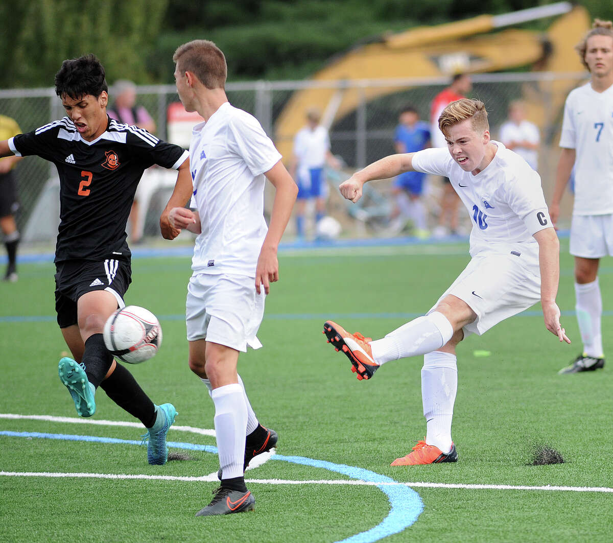 At left, Stamford's Ariel Sandoval (#2) is unable to block the scoring strike of Darien's Hunter Kooyman (#10), right, who connected for the second goal of the game during the boys high school soccer match between Darien High School and Stamford High School at Darien, Conn., Tuesday, Sept. 22, 2015. Darien won the match over Stamford, 5-2.