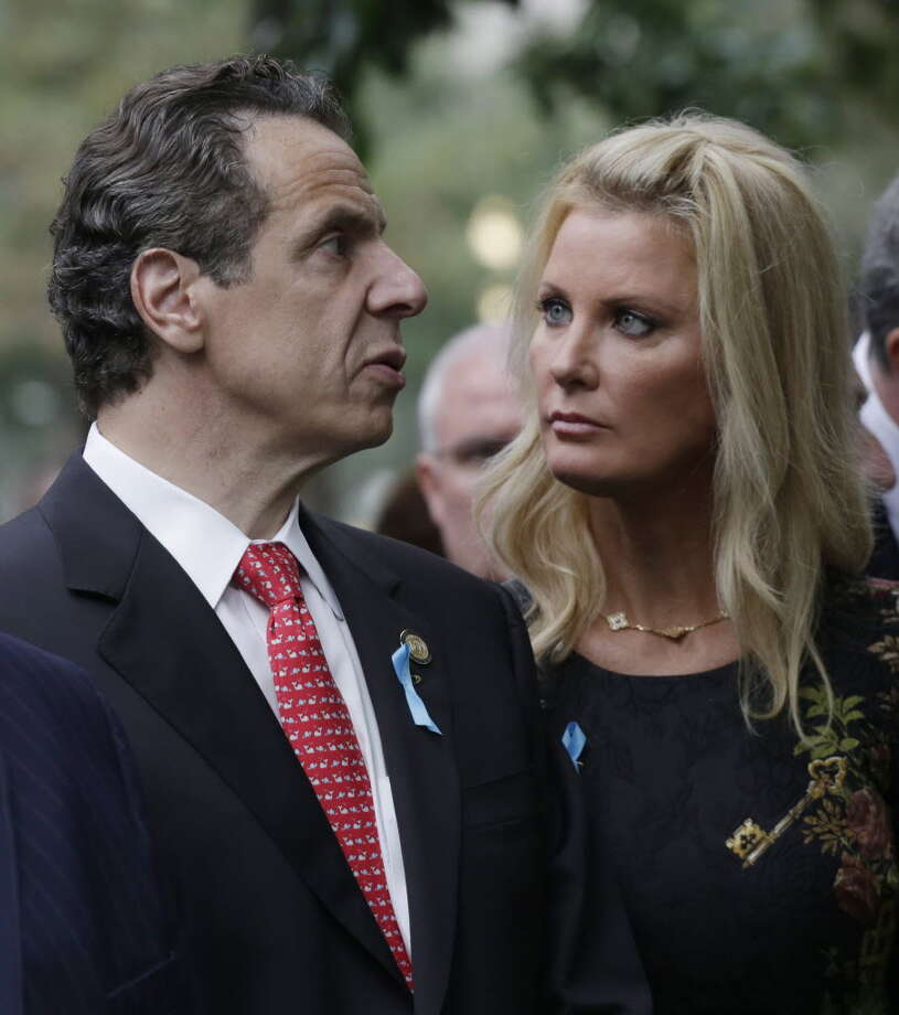 New York Governor Andrew Cuomo (L) and and his girlfriend Sandra Lee talk during memorial observances held at the site of the World Trade Center on September 11, 2014 in New York City. This year marks the 13th anniversary of the September 11th terrorist attacks that killed nearly 3,000 people at the World Trade Center, Pentagon and on Flight 93. (Photo by Mark Lennihan-Pool/Getty Images)