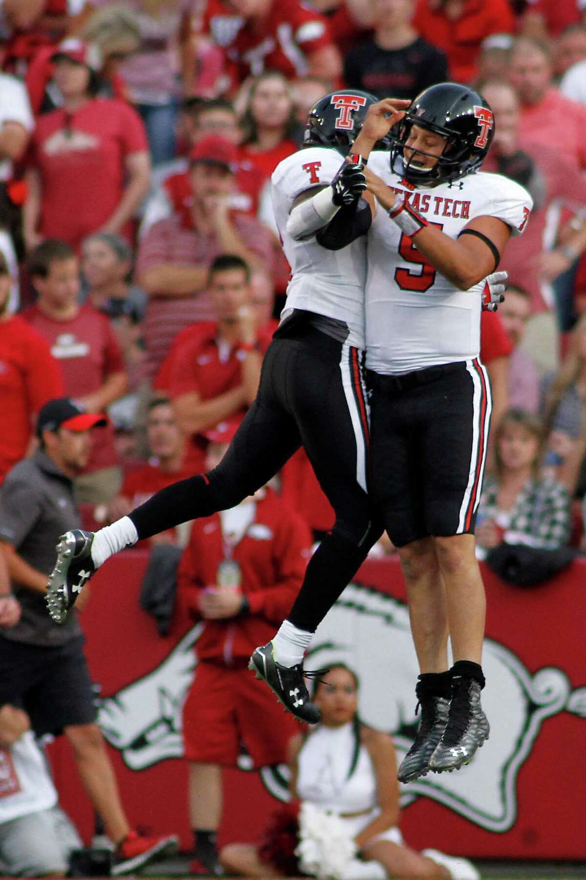 Texas Tech's Patrick Mahomes II, right, and Devin Lauderdale (6) celebrate after a touchdown during the first half of an NCAA college football game against Arkansas, Saturday, Sept. 19, 2015, in Fayetteville, Ark.