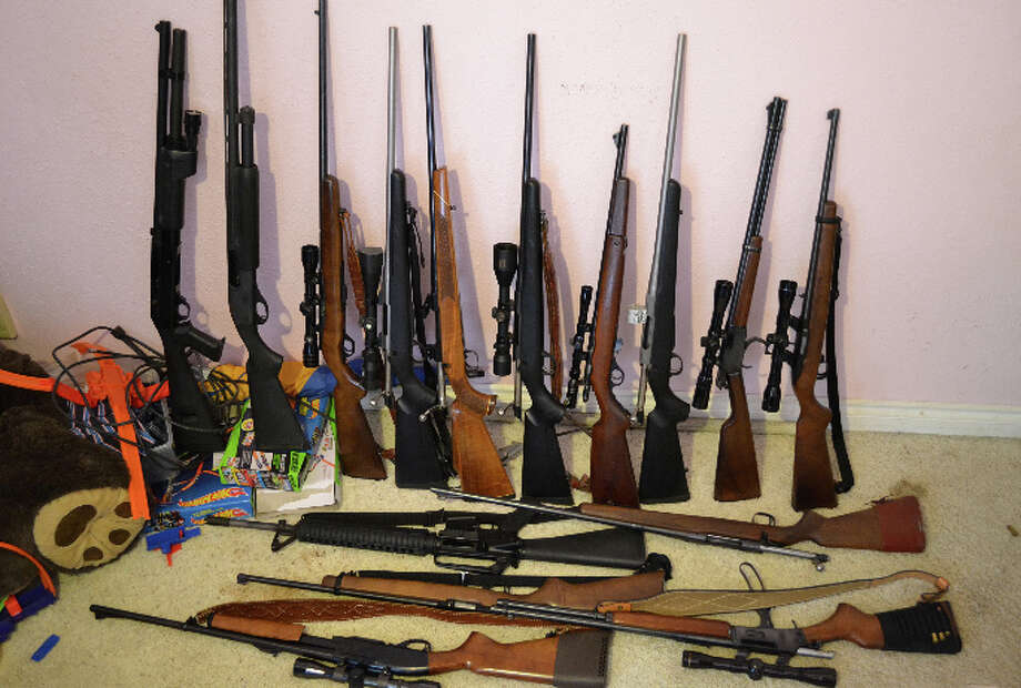 Guns seized during searches of homes, cars and an auto shop related to The Wolfpack Social Club marijuana dispensary in Seattle. Pictured in a Seattle Police Department photo. Photo: Seattle Police Department